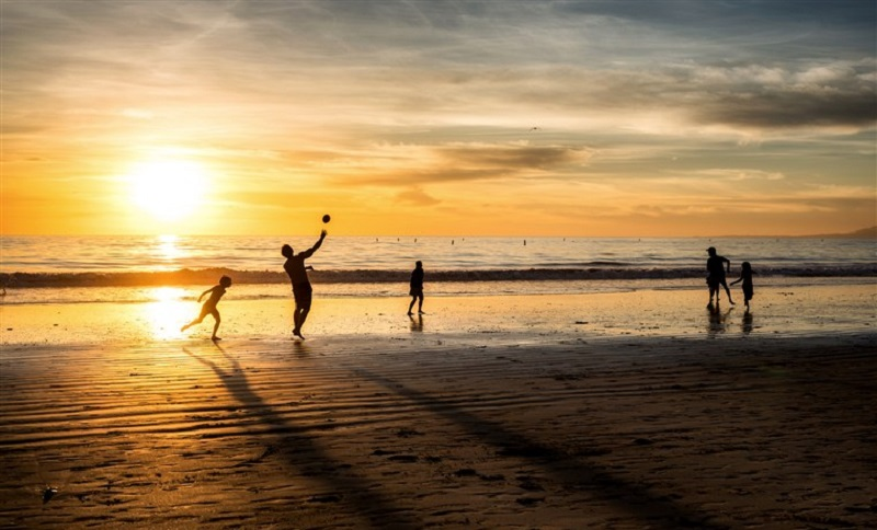 Família curtindo praia de Maceió